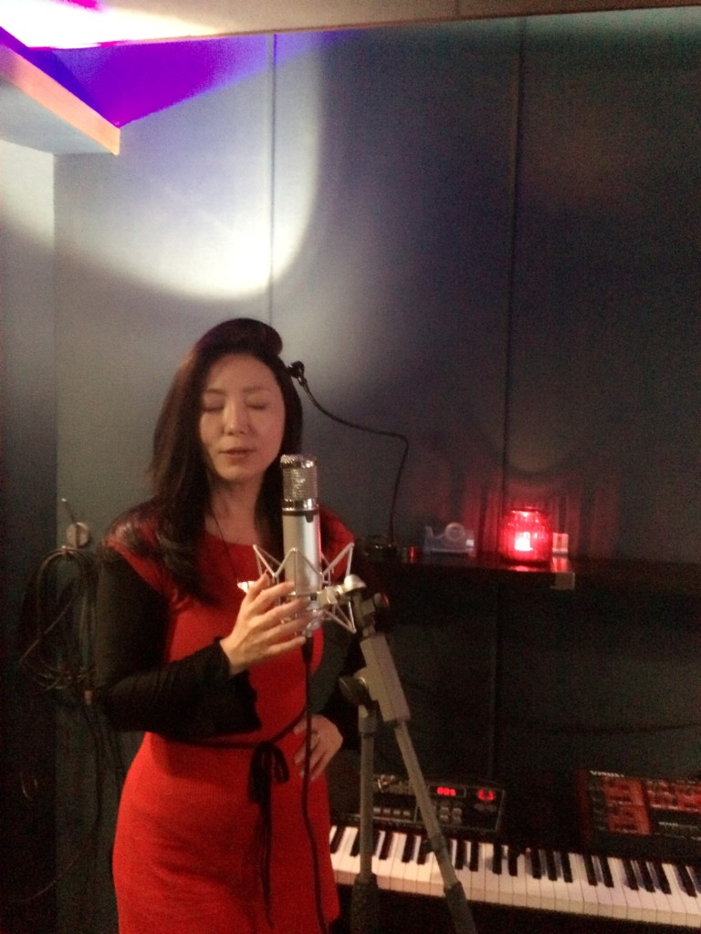 Cheng Lin recording 'We Must Look Higher'  in the studio