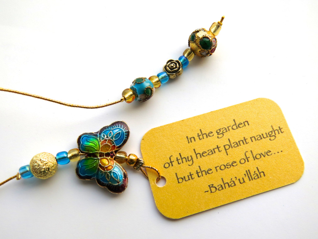 Turquoise butterfly cloisonne beaded bookmark with quote 'In the garden...'