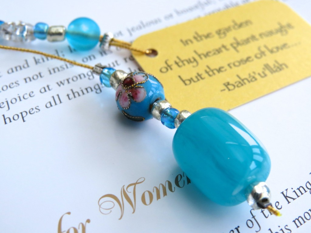 Turquoise cloisonne beaded bookmark with quotation 'In the garden...'