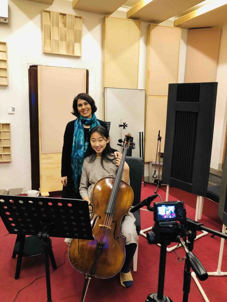 Elika and Brenda - the cellist - in the studio recording for Eiika's songs