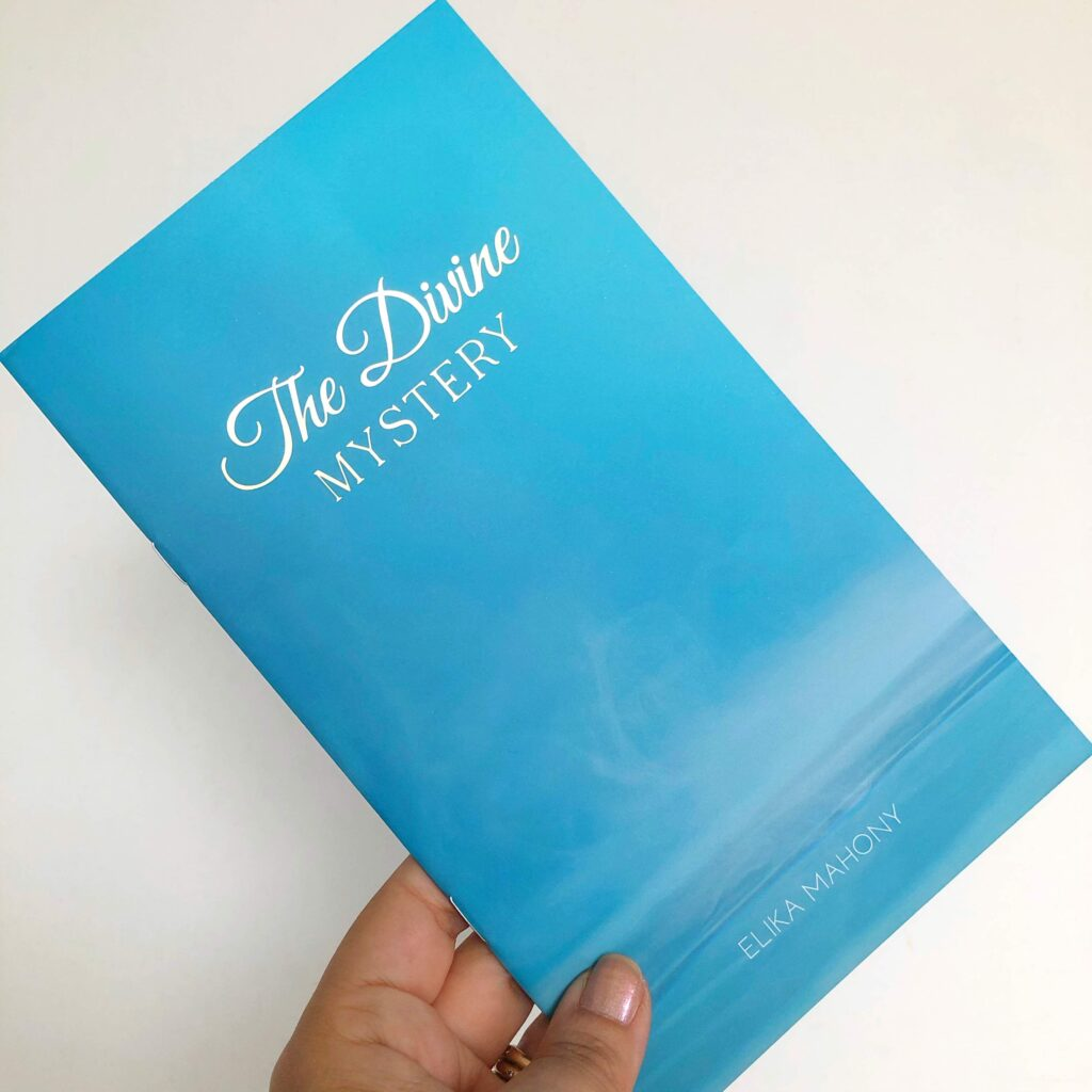 The Divine Mystery booklet-album