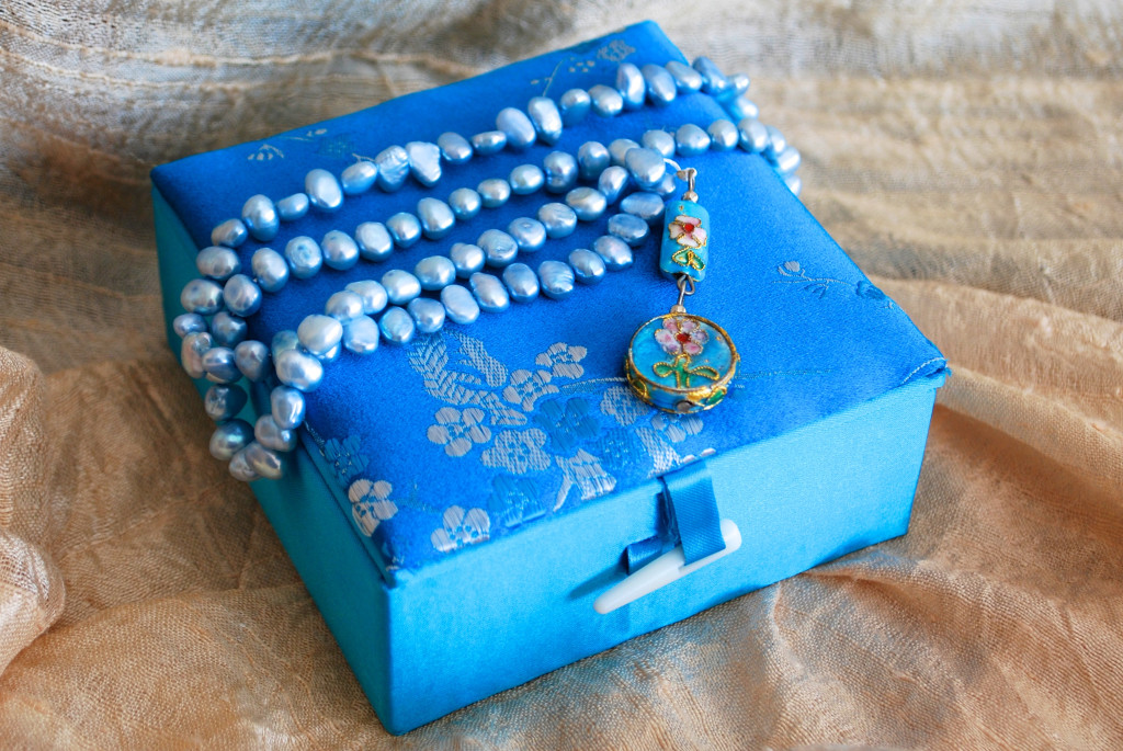 Sky blue water pearl prayer beads packaged in floral silk box