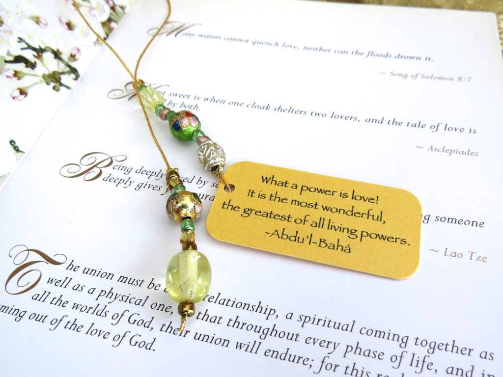 Beaded bookmark with inspiring quotation 'What a power is love...'